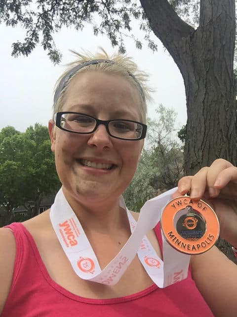 My race medal!  I loaded my bike before the picture and got tire grease all over my face, oh well!